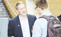 Prof. Tröster talking to a guest at a KLU Open Day