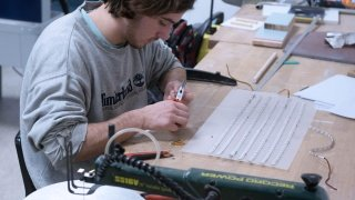 Student working in the workshop